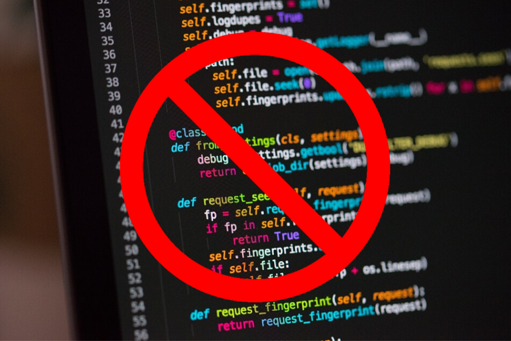 An image of code with a banned sign on it.